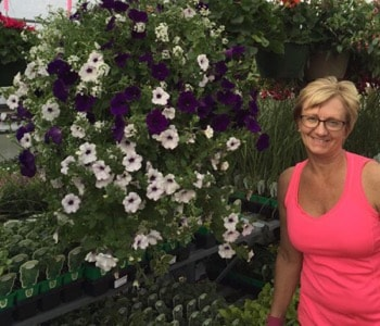 Pam from Pam's Greenhouses with Petunia Plant